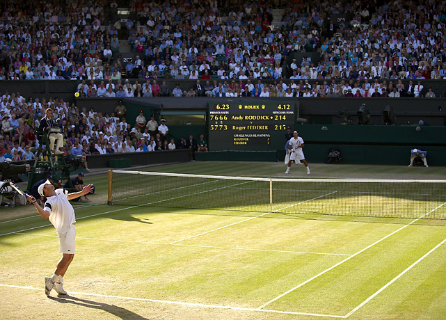 Roddick and Roger Federer play deep into the deciding fifth set during their memorable marathon final at Wimbledon.