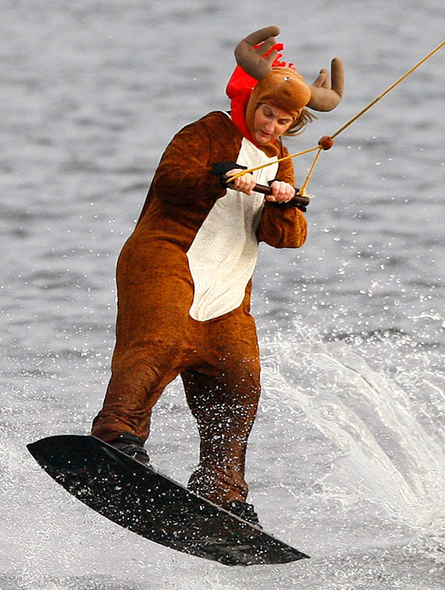 A woman wakeboards dressed as an elk; hopefully, that costume cushions any pain if and when she wipes out.