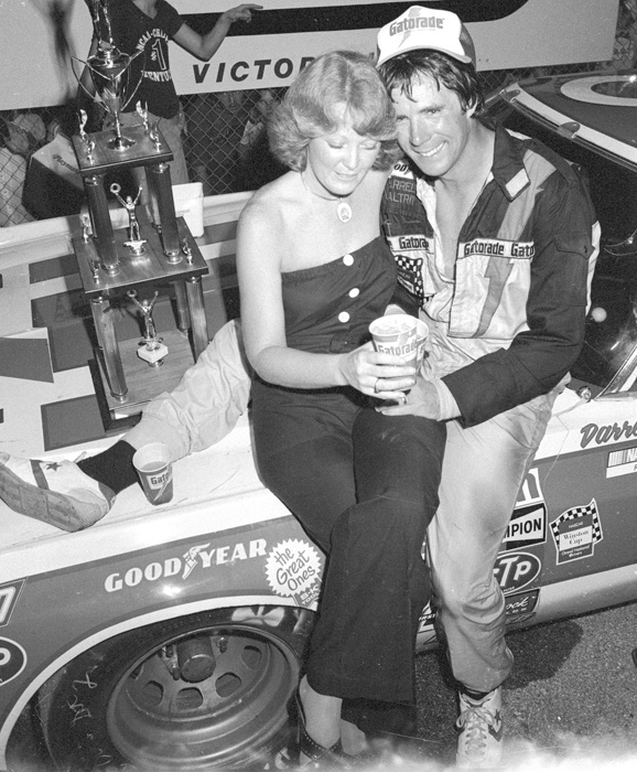 Darrell and Stevie Waltrip pose in Victory Lane after the 1979 Nashville 420. Stevie is known for being the first NASCAR wife to attend races and sit in the pit box.