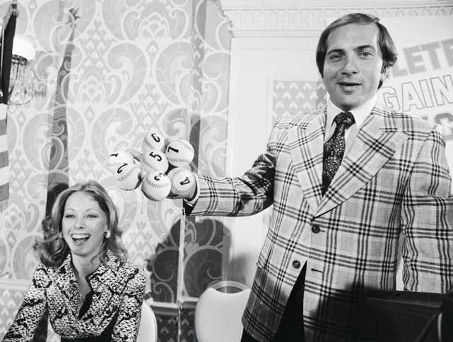 Johnny Bench gets a laugh from his wife, Vickie, as he somehow holds seven baseballs in his hand at one time. The couple were married in 1975 and divorced a year later.