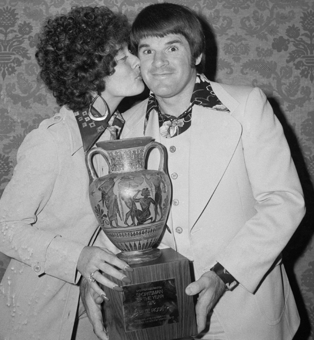 Pete Rose is rewarded with a cup and a kiss by his wife Karolyn for being named  Sports Illustrated 's 1975 Sportsman of the Year. The two were married from 1964 to 1980.