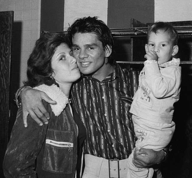 Lightweight champion Roberto Duran receives a kiss from his wife, Claudine, after a unanimous decision victory over Edwin Viruet in 10-round non-title bout.