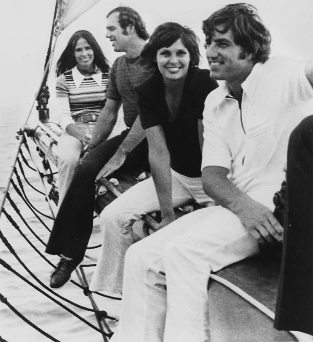 Yankee pitchers Fritz Peterson and Mike Kekich sit on a schooner's bowsprit with their wives, Marilyn Peterson and Susanne Kekich, on Long Island Sound in 1972. The two couples would make news a year later when the two  teammates swapped families, including wives and children.