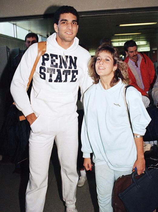 The 1986 Heisman Trophy winner, Vinny Testaverde arrives at New York's LaGuardia Airport with girlfriend Jacqui Alleque. Surprisingly, the Miami QB was wearing a Penn State sweatshirt.