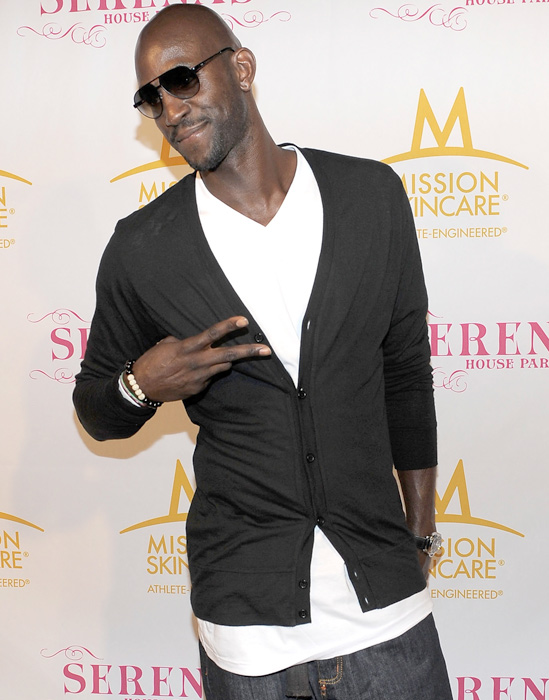 Kevin Garnett flashes a smile and a peace sign at a pre-ESPYs party.
