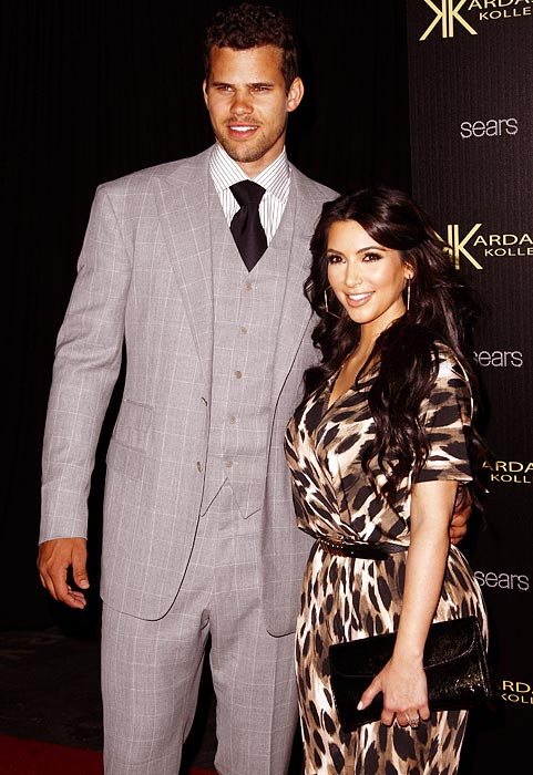 The newly married Kris Humphries now has a permanent fashion accessory - his new wife, Kim Kardashian.