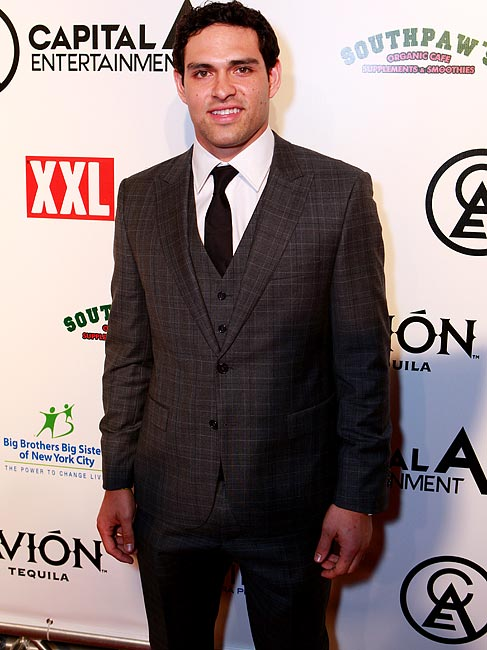 Only Mark Sanchez could wear a plaid suit and look this good.