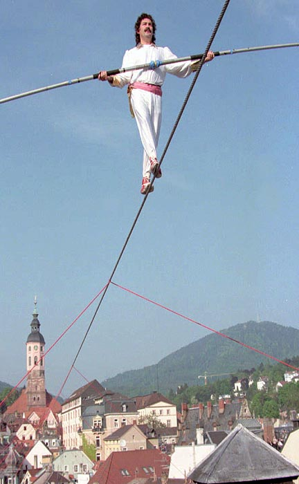 Falco Traber balances on a 28-millimeter diameter wire 65 feet above the old town of Baden-Baden in southwest Germany. Traber set a new world record of 2,116 feet balancing on an unsecured high wire.
