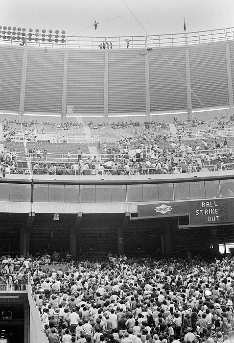 Sixty-seven-year-old Karl Wallenda, of the Flying Wallendas starts a 600-foot walk across Philadelphia's Veteran's Stadium between halves of Montreal Expos vs. Philadelphia Phillies game in Philadelphia, Pa. AUG. 13, 1972. At center he sits down on wire and waves to ground crew to tighten ropes preventing swaying of wire.