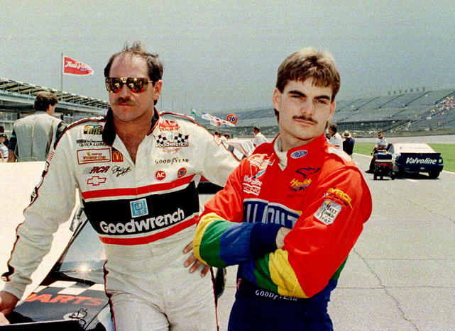Gordon, in his rookie year, watches qualifying for the 1993 Pepsi 400 with Dale Earnhardt. Gordon went on to win the Rookie of the Year award but did not get his first career victory until 1994.