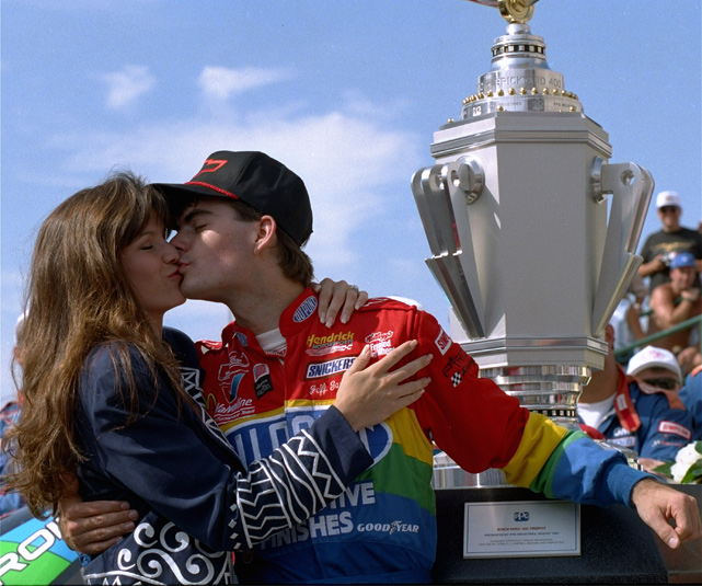 Gordon and his then-fiancee Brooke Sealey celebrate Gordon's win of the inaugural Brickyard 400 in 1994. The couple divorced in 2003.
