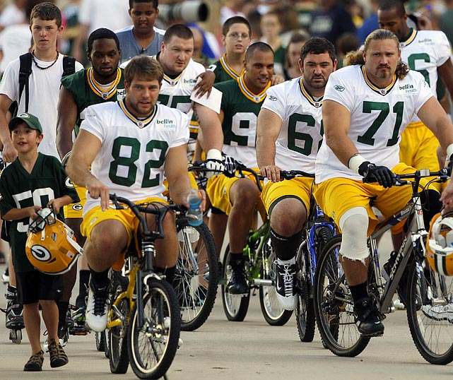 The end of the NFL lockout meant that the Packers could go back to work, riding kids' bikes to training camp in what has been a Green Bay tradition for more than 40 years.