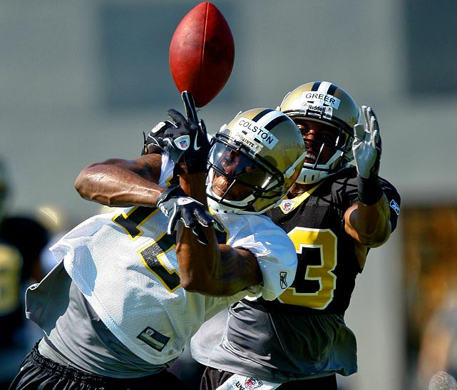 Wide receiver Marques Colston (left) goes up for a pass with cornerback Jabari Greer defending him during training camp.