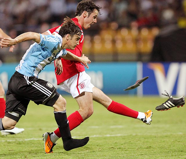 England's Adam Smith appears to be kicking Argentina's Nicolas Tagliafico's shoe, not the ball, during a World Cup U20 match.