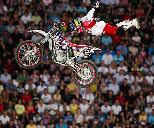 """Look, Ma, no hands!"" Japan's Eigo Sato shows off a no-handed move during the final of the fifth stage of the Red Bull X-Fighters World Tour."