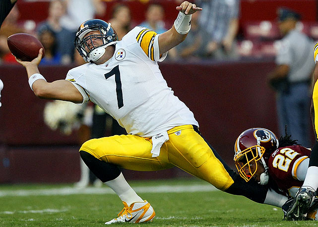 All the leg lunges performed in training camp are really paying off for Pittsburgh Steelers quarterback Ben Roethlisberger (7) as he tries to dump the ball before being pulled down by Washington Redskins cornerback Kevin Barnes during their preseason football game.