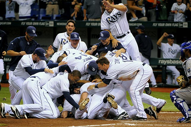 The Legend of Sam Fuld, bottom center, continues as his Tampa Bay Rays teammates pile on him after he hit a triple, scoring Elliot Johnson, and scored himself on a throwing error by Kansas City Royals second baseman Johnny Giavotella to end the game and win 8-7.