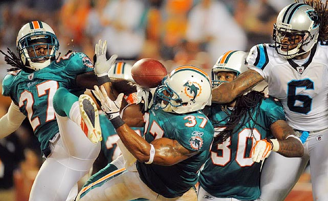 Miami Dolphins cornerback Benny Sapp (27) seems to be taking the name football literally.