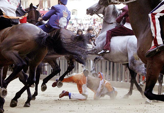 Leocorno neighborhood rider Jonathan Bartoletti falls during a training session for the Palio, the famous break-neck bareback horse race around Siena's main square, Italy. The annual Palio pits Siena neighborhoods against one another and it's a major tourist draw for this Tuscan city. Each neighborhood puts up a horse and rider to race three times around the slippery, dirt covered cobblestone track.