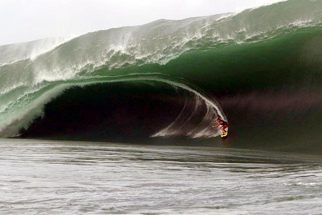 Surfer Bruce Irons of Kauai, Hawaii carves a beautiful curve in the record-breaking Tahiti waves.