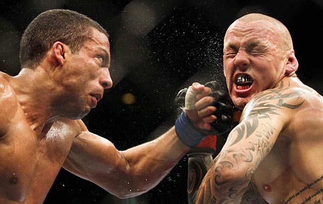 Brazil's Edson Barboza, left, smacks Ross Pearson of England during their lightweight 'swing' mixed martial arts bout at the UFC in Brazil.