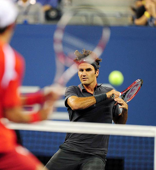 Roger Federer stares down his opponent Santiago Giraldo during his first match of the U.S. Open. Federer takes the match in three sets.