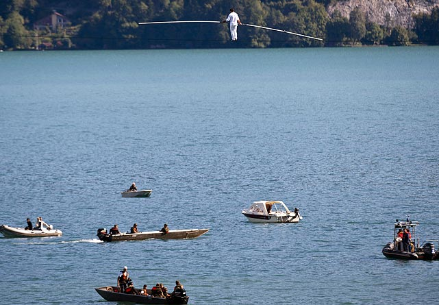 Swiss tightrope artist Freddy Nock walks on a rope high above the Thunersee Lake in Switzerland. Due to winds and rain, Nock later had to abort his attempt to cross the lake on the rope. Nock is attempting to set a new world record by achieving seven tightrope records in Germany, Austria and Switzerland in seven days.