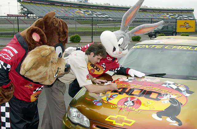 Jeff Gordon (center) and his impromptu pit crew, Bugs Bunny (right) and the Tasmanian Devil, leave their mark on the Monte Carlo 400 pace car on June 7, 2001.