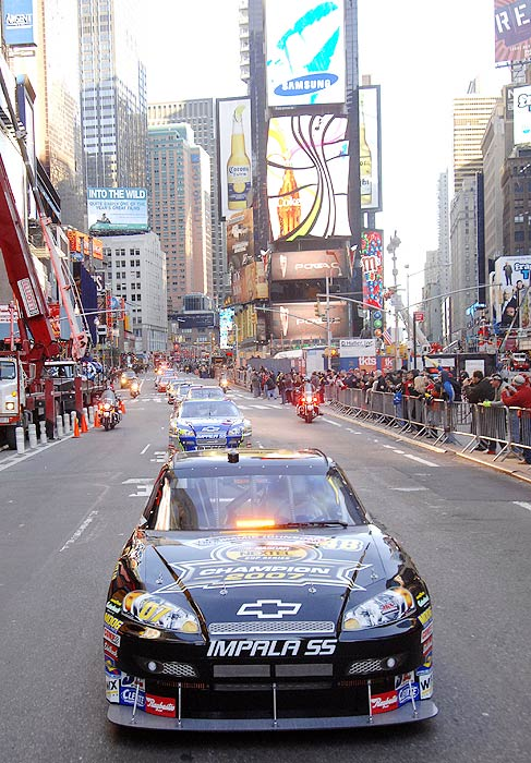 A pace car leads NASCAR's best down Broadway in Nov. 2007.