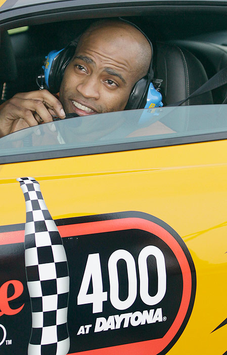 NBA star Vince Carter, then with the Orlando Magic, peeks out over the driver's side window of the pace car before the Coke Zero 400 at Daytona on July 4, 2009.