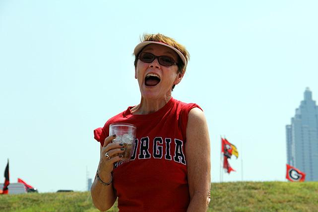 A Georgia fan celebrates Auburn's on-field misfortunes.
