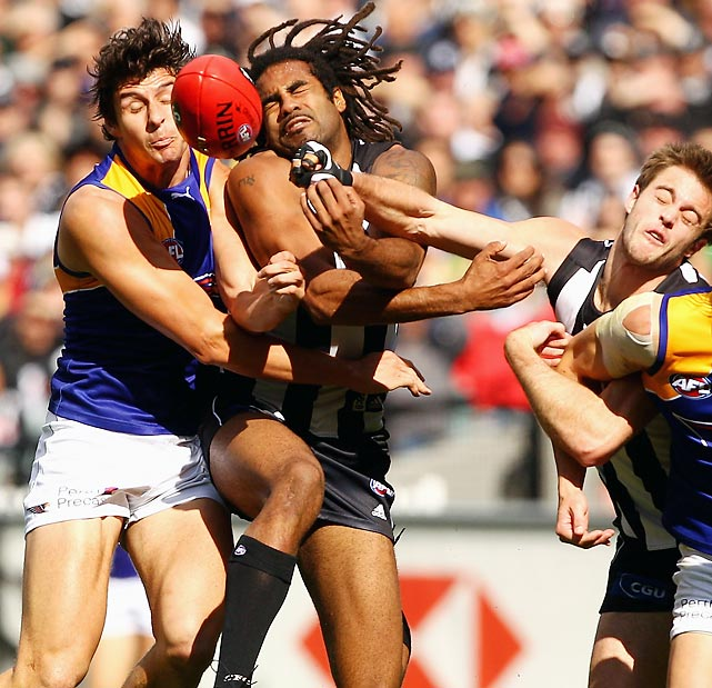 The Eagles' Andrew Embley (left) crashes into Harry O'Brien of the Magpies during the AFL first qualifying match, resulting in a mass of tangled arms.