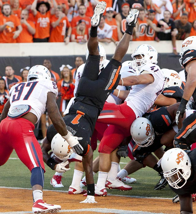 OSU running back Joseph Randle (1) shows off his gymnastics skills as he scores a touchdown against the Arizona Wildcats.