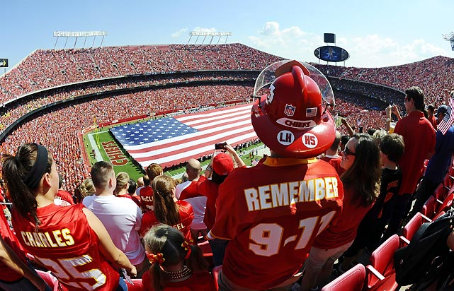On the NFL's opening day, teams and fans across the nation commemorated the 10th anniversary of the attacks on New York twin towers and the Pentagon. This fan, at the game between the Buffalo Bills and the Kansas City Chiefs, wore a fireman's hat and 9-11 jersey in remembrance of the day.