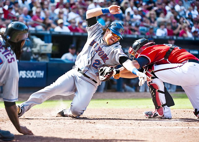 Mets' second baseman Justin Turner can't avoid the tag from Atlanta's Brian McCann. The Braves still couldn't muster enough runs, and fell to the Mets' 7-5 on Sept. 18.