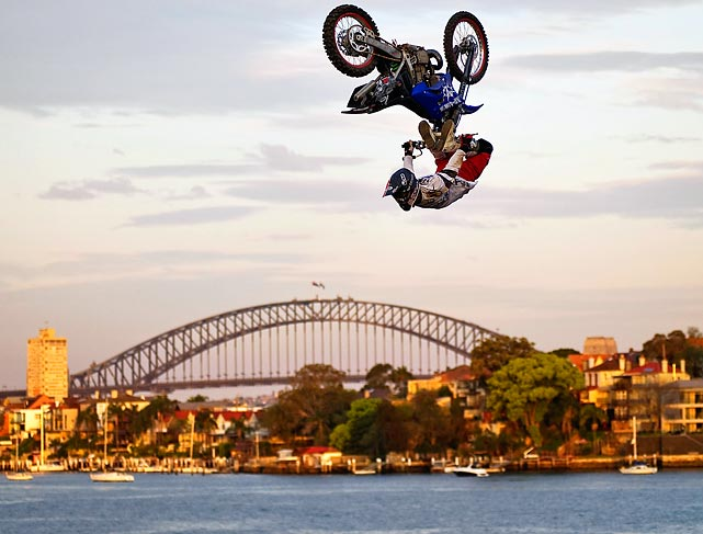 Eigo Sato of Japan presumably started this move off from the ground, but he looks like he's driving in the sky at the Red Bull X-Fighters world tour in Sydney, Australia.