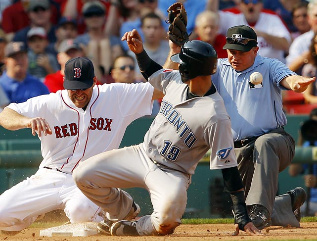 Blue Jays' outfielder Jose Bautista reaches third safely on his teammate's single because Red Sox third baseman Kevin Youkilis cannot hold onto the throw. Toronto defeated Boston 5-4 on Sept. 14.