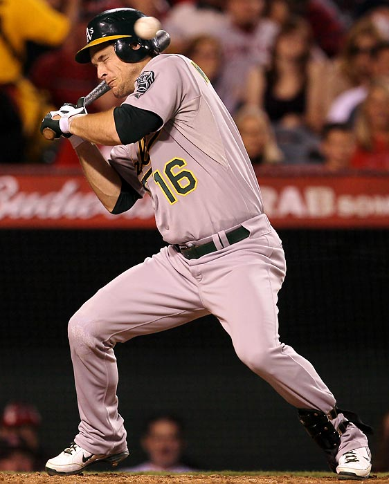 Oakland's Josh Willingham found this pitch too close for his comfort during a game against the Anaheim Angels.