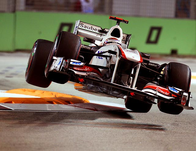 Kamui Kobayashi -- of no relation to the hot dog eater -- loses control of his car during a qualifying session of the Singtel Singapore Grand Prix.
