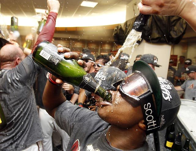 Apparently this is what a National League West Champion looks like. Justin Upton celebrates in the locker room after the Diamondbacks defeated the Giants to clinch their division.