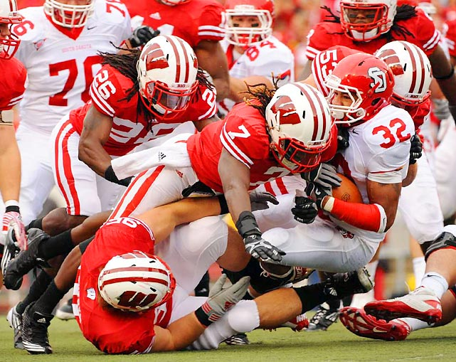 South Dakota running back Marcus Sims get stuffed by a wall of Badger defenders. Wisconsin only allowed 173 yards total offense in its 59-10 destruction of the Coyotes.