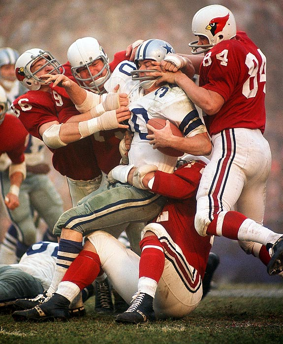 How tough was Dan Reeves (#30), an eight-year all-purpose back for the Cowboys? Here it takes four Cardinals to drag him to the ground, mauling him and grabbing his face mask in the process.