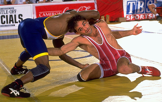 John Smith (red) has more world championships than any other wrestler in American history. Not only did he win gold at the 1988 and 1992 Olympic games, but also the Oklahoma State standout won four titles in non-Olympic years and finished his career with a 100-5 international record.