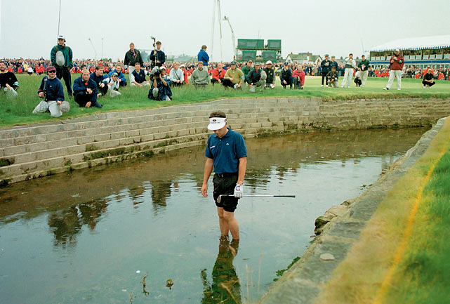 He stood on the 18th tee Sunday at Carnoustie with a three-shot lead, hoping -- expecting -- to become the first Frenchman since 1907 to win the Open. But Van de Velde decided not to make the safe play with his approach shot. Instead, in one of the biggest decision-making gaffes in golf history, Van de Velde attacked the green ... and found trouble. He had to make a six-foot putt for triple bogey just to get into a three-man playoff, but there was no redemption, as Paul Lawrie emerged as the winner.