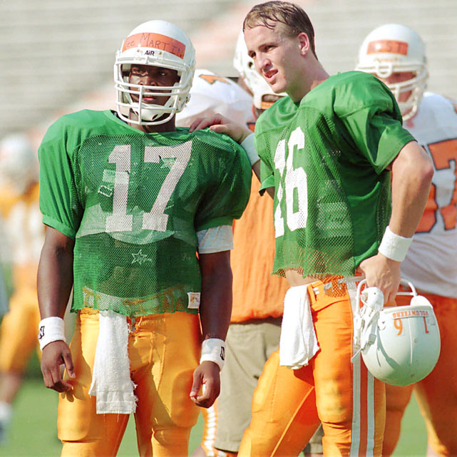 "Martin did what Manning couldn't do: win a national title at Tennessee. He did so in 1998, his first year in succession of Manning. As a freshman in 1996, Tamaurice Nigel ""Tee"" Martin was needed from the get-go as Manning's backup with Jeremaine Copeland being better suited as a receiver and Jeremy Bates transferring.    Career Tennessee stats (as Manning's backup): 10 games, 8 of 16, 111 yards, 1 TD, 1 INT."