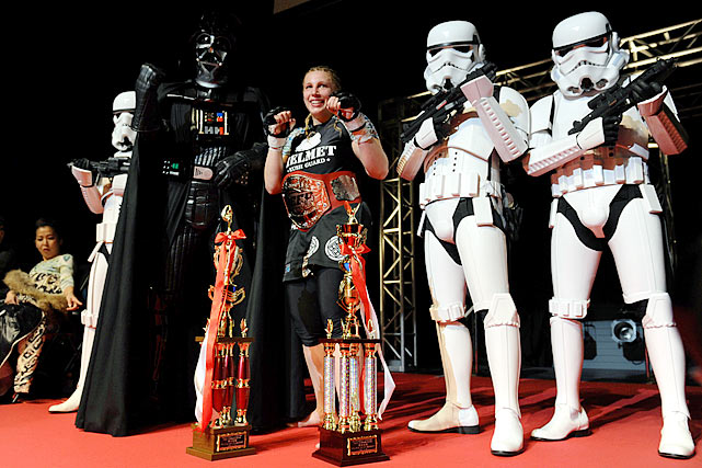 MMA fighter Amanda Lucas, and daughter of Star Wars visionary George Lucas, poses with Darth Vader and several stormtroopers after earning her first MMA championship in Japan at Deep 57 on Feb. 18, 2012.