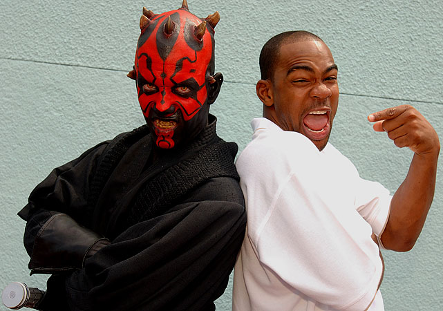 "Redskins wide receiver Antwaan Randle El poses with Darth Maul on May 19, 2006, during the opening day of the month-long ""Star Wars Weekends"" fan festival at the Disney-MGM Studios in Lake Buena Vista, Florida."