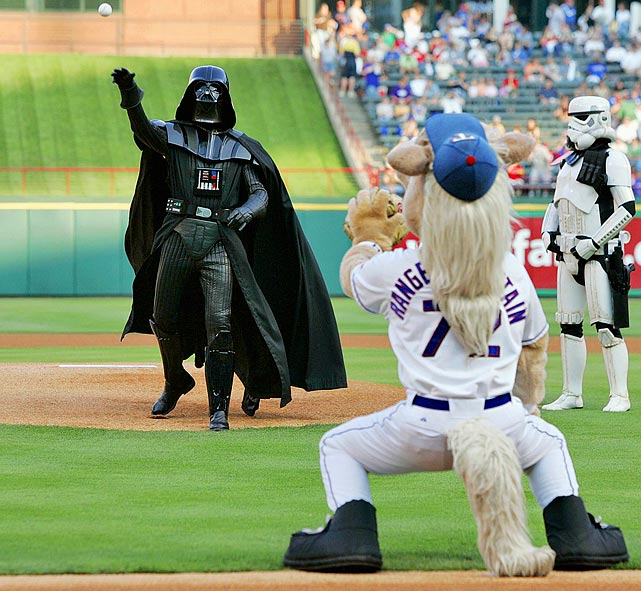 Darth Vader makes the honorary first pitch to Captain, the Rangers mascot, prior to a game against the Tigers on June 5, 2007 in Arlington, Texas.