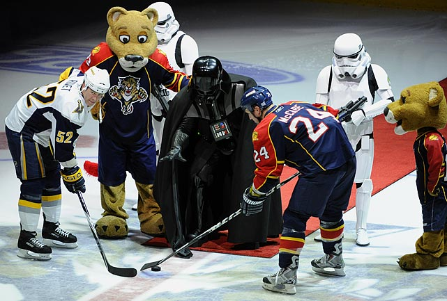 Darth Vader and stormtroopers join the Panthers mascot Stanley C. Panther on the ice as Vader drops the puck for the Sabres' Craig Rivet and Panthers' Bryan McCabe on Oct. 21, 2009 in Sunrise, Florida.