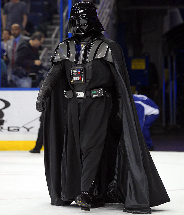 Darth Vader walks onto the rink during a promotion between periods of a game between the San Jose Sharks and the Tampa Bay Lightning at the Tampa Bay Times Forum on Feb. 16, 2012.